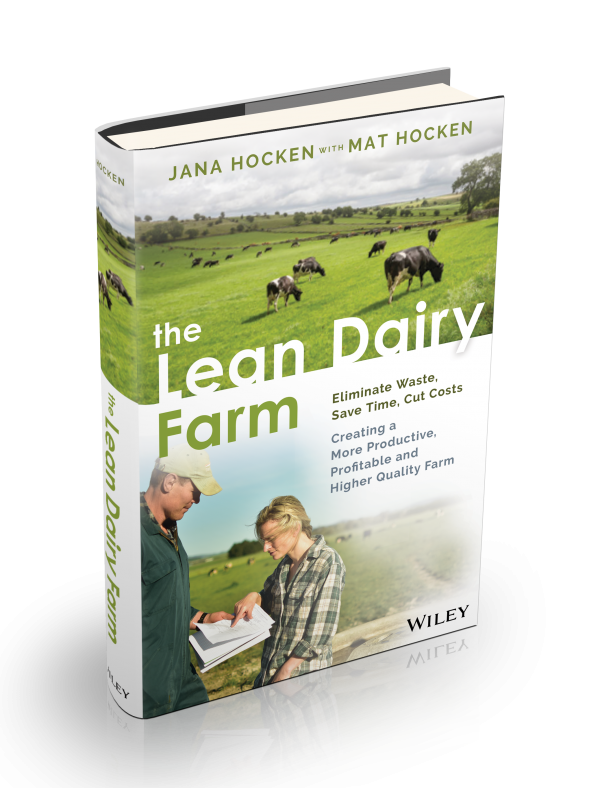 The Lean Dairy Farm Book Cover - 2 people looking at a chart on a dairy farm